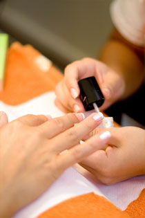 Manicure Nail Polish Being Applied by Technician