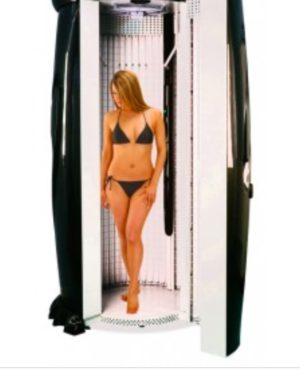 Lady in a standing sunbed receiving a tanning session